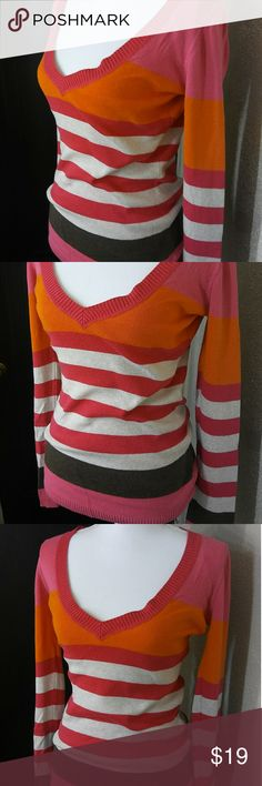 AERO Aeropostale Color Block Stripe V Neck Sweater *EUC* AERO Aeropostale Color Block Stripe V Neck Sweater. Great colors make this sweater super fun and unexpected. Pink, orange, light gray/cream, and brown stripe. V neck and long sleeve.   *If you know AERO, you know they run small. My mannequin also models XS clothing and this top seems to fit her well hehe. *** I would say more of a medium true to size or oversized small **** Aeropostale Sweaters V-Necks