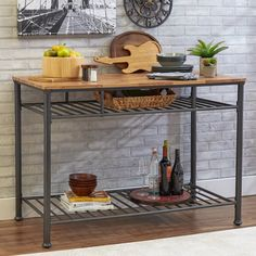 Crafted from metal and wood and showcasing an open design, this 3-tiered kitchen island brings style and function to any ensemble. Use the top to prep farm fresh dinners while stowing your favorite serveware on the bottom shelf.