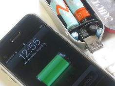 Make your own backup phone charger out of an Altoids tin and a couple of batteries.