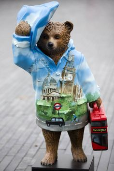"TO GO WITH AFP STORY BY MAUREEN COFFLARD A picture shows a Paddington Bear statue named ""Bear of London"", customised by mayor Boris Johnson, is pictured during a photo call ahead of the release of ""The Paddington Trail"" film in London on November 3, 2014. The movie ""Paddington"" has sparked a resurgence of interest in the bear from darkest Peru, with exhibitions, statues and a new book of his adventures coming out before the New Year. Fifty statues of the bear which will be dotted out ..."