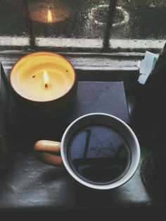 Coffee, candle, a good book & a rainy night
