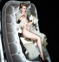 January Jones long legs nude in a fur and stilettos