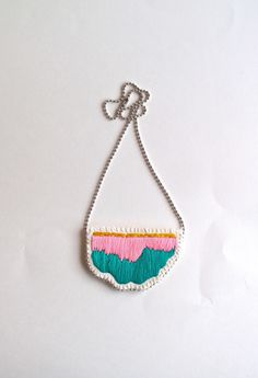 Embroidered abstract pendant necklace in colors of bright pink, emerald green and pretty yellow on a silver ball chain perfect for Spring by AnAstridEndeavor on Etsy https://www.etsy.com/ie/listing/230424408/embroidered-abstract-pendant-necklace-in