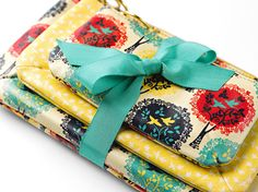 """Love the """"Song of Spring"""" print on our Key-Per bags as much as we do?  Download the wallpaper for your tech and watch the video for the print on our blog! #Fossil #SongofSpring #Spring Register to Win Here: http://on.fb.me/Y44D7O"""