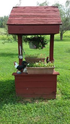 My husband built this wishing well to cover the well pump. The bucket and dipper were his grandmother's real water bucket.