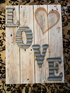 This beautiful Country Chic sign measures approximately 14 x 19. It was crafted with reclaimed wood and features the word Love with 5 1/2