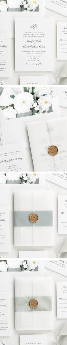 Floral wedding invitations with a script monogram