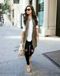 Layered outfit | Long khaki green vest, white blouse and nude accessories