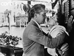"""Renato de Rossi: """"I am a man and you are a woman. But you say, 'It's wrong...' You are like a hungry child who's been given ravioli to eat. 'No,' you say, 'I want beefsteak.' My dear girl, you are hungry. Eat the ravioli."""" Jane Hudson: """"I'm not that hungry."""""""