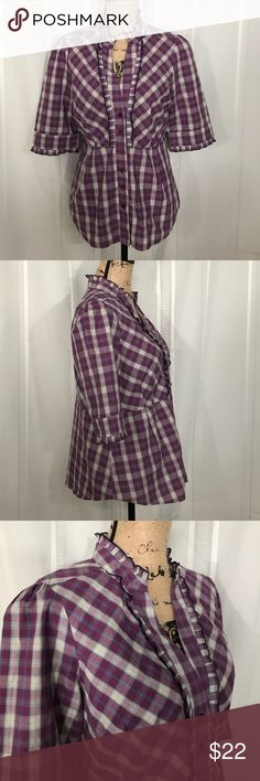 "EDME & ESYLLTE Pink/Purple Plaid Ruffle Button Up Plaid shirt with Button Front and Mixed plaid pattern has half sleeve with pleated ruffle trim on sleeve and collar. Pleat is edged with black thread. Shoulder at seam 15-1/4"", length 23"" at front/back, chest 20"" flat. Anthropologie Tops Button Down Shirts"