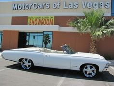 1967 Chevrolet Impala SS Convertible $23,950.00. I want mine in black.. but the white look hot