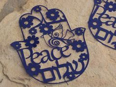 Paper cut  -Peace in 3  languages Hebrew, Arabic and English. $23.00, via Etsy.