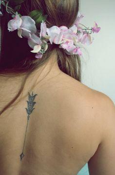 small-arrow-tattoo-on-back