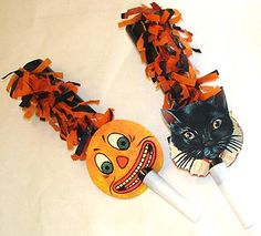 """Festive Jol and Cat Party Horns Our Festive Jol and Cat Party Horns are perfect for celebrating the witching hour with a little flair and noise! Black party horns are decorated with out black/orange tissue festooning and old vintage jack o'lantern and cat faces. Set of 4: 2 of each style. Size: 9"""" tall."""