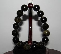 "0.7"" China Certified Nature Black Obsidian Round Pearls B... https://www.amazon.com/dp/B06XW1WQRZ/ref=cm_sw_r_pi_dp_x_TlaDzbMT62QNZ"