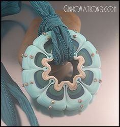 Etched Turquoise is a ready-to-wear handmade wheelie bead pendant (created by Ginny Hampton)