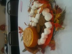 Centerpiece for fall baby shower I made. Pumpkin dip in real pumpkins with ginger snaps, vanilla wafers, and marshmallows :)