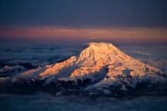 Washington's Mt Rainier at sunset. The photo was taken by reddit user -rabid-, who captured the east side of the mountain from his window seat on an airplane.