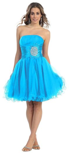 This fun flirty dress has a strapless top with a waist band and a sequin design. The skit is a knee length bottom with a ruffled tulle that peeks out. Fabric: Tulle Zipper Back Matching Complimentary
