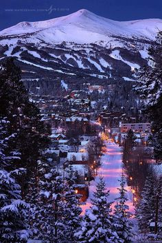 MRiley_Pinspier_8/16. I used to vacation in Colorado every summer and this photo brings back memories. I like that you can see the whole town, the snowy mountain and the bright lights