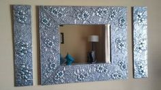 Tin foil!!! All you need is modpodge, an old frame, and tin foil!!! :) I bet it would work with metallic tissue paper too