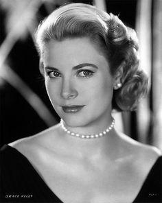"""Grace Kelly in my favorite Hitchcock film """"Rear Window"""".  Loved the dress."""