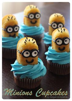 Minions Cupcakes. Homemade chocolate cupcakes and blue-tinted vanilla buttercream frosting as the base. The minions are made with 1/2 Twinkie, chocolate jimmies for the hair, plus white Smarties and chocolate frosting for the glasses and smiles.