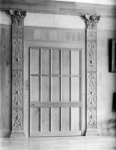 Carved pilasters on either side of a door at Castle Drogo.