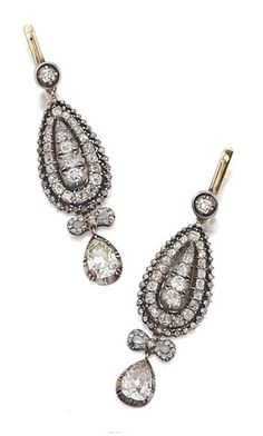PAIR OF DIAMOND PENDANT-EARRINGS, LATE 19TH CENTURY. Designed as pear-shaped openwork plaques set with small old-mine and rose-cut diamonds, supporting 2 pear-shaped pendants together weighing approximately 2.75 carats, surmounted by rose-cut diamond bows, mounted in gold and silver.