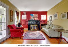 stock-photo-living-room-with-red-and-yellow-walls-and-fireplace-in-old-american-house-128660822.jpg 450×318 pixels