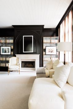 Bold dark walls and white panelled ceilins in this living room design | ©AlyssaRosenheck2015 photography with Chad James for Elle Decor