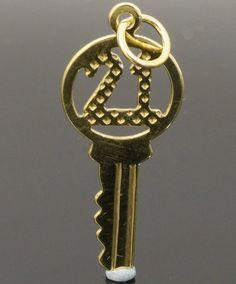 9Carat Yellow Gold '21' Key Charm (Approx 10x22mm)  https://www.jollysjewellers.com/product/9carat-yellow-gold-21-key-charm-approx-10x22mm/