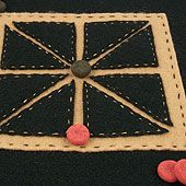 In this project, make a felt or paper game board for Achi, a game from Ghana which goes beyond tic-tac-toe.