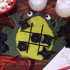 "Leisure Arts has wide range of collections on Tic Tac Toe plasic canvas patterns with toad shaped game board and playing pieces. Kids will love this ""ribbiting"" game for trips and rainy days. Plastic Canvas Ornaments, Plastic Canvas Crafts, Plastic Canvas Patterns, Quilt Patterns, Stitch Patterns, Frog Crafts, Kid Crafts, Blessing Bags, Tic Tac Toe Game"