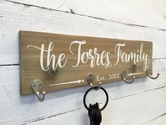This personalized wooden key holder sign features zinc hooks for coats, jackets, hats or keys. Personalized with your own family name and Est date. This is a natural wood look key holder painted with Personalized Wooden Signs, Custom Wood Signs, Rustic Signs, Rustic Decor, Wooden Key Holder, Barn Wood Crafts, Pallet Crafts, Wooden Projects, Pallet Projects