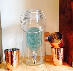Drink dispenser and copper cups - find them in both our Sheffield and Lincoln shops
