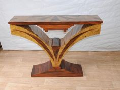 Google Image Result for http://canonburyantiques.files.wordpress.com/2012/08/art-deco-inlay-hall-table-console-tables-vintage-furniture.jpg