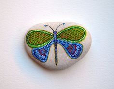 Hand Painted Stone Dragonfly Beach pebble with hand-painted designs in acrylics © Sehnaz Bac 2015  I paint and draw all of my original