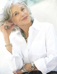 A crisp, white shirt with a collar is so flattering for women over 50. The white bounces light onto the face. The open collar is perfect for adding an interesting necklace. Keep it casual by turning back the cuffs just twice. Put on a big watch and some bracelets for a more youthful look.