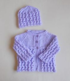 Free knitting pattern. Pattern category: Baby Booties, Baby Cardigan, Baby Hats. DK weight yarn. 150-300 yards. Features: Lace, Raglan. Easy difficulty level.
