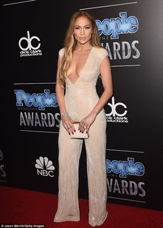 Who's the sexiest woman alive? Pop diva Jennifer Lopez displayed her God-given cleavage in a nude-coloured jumpsuit