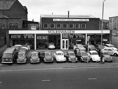 A 1970s photograph of Mill Street Volkswagen Garage, Stourbridge Road, Stourbridge, West Midlands. Featuring Volkswagen Beetles, VW Camper Van, VW Variant. #Volkswagen #Beetle #VWVan #VolkswagenVan #Stourbridge