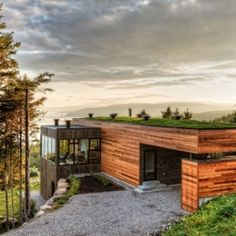 Contemporary home in Canada with panoramic views of mountainous landscape.