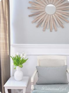 DIY paint stick sunburst mirror.