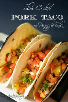 A flavorful recipe for Slow Cooker Pork Tacos w/a Pineapple Salsa. www.thekitchenwife.net