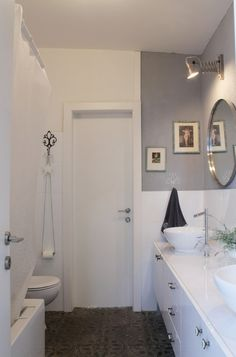 eclectic bathroom by Esther Hershcovich - check out the TP holder - a chain!