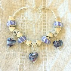 Excited to share the latest addition to my #etsy shop: Purple Heart Glass Lampwork Charm Beads Silver Plated Bracelet 7-9 Inches Adjustable http://etsy.me/2DaJV3V #purple #heart