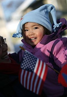 Small child holding a flag.