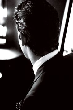 The back of Christian, just before he turns around and sees Ana before attending the Masquerade Ball.