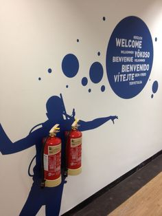 Environmental graphics are a great way to create a fun and inspiring workplace and keep your employees happy! It gives some fun to something very boring like Fire Extinguishers Environmental Graphic Design, Environmental Graphics, Wayfinding Signage, Signage Design, Directional Signage, Office Graphics, Office Branding, Identity Branding, Visual Identity